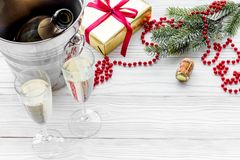 New Year 2018 background. Champagne in bucket, glasses with beverage, spruce branch and decoration on grey background.  Royalty Free Stock Photos