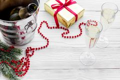 New Year 2018 background. Champagne in bucket, glasses with beverage, spruce branch and decoration on grey background Stock Images