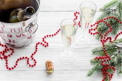 New Year 2018 background. Champagne in bucket, glasses with beverage, spruce branch and decoration on grey background.  Royalty Free Stock Photography