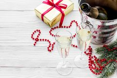New Year 2018 background. Champagne in bucket, glasses with beverage, spruce branch and decoration on grey background.  Stock Photography