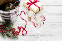 New Year 2018 background. Champagne in bucket, glasses with beverage, spruce branch and decoration on grey copyspace. New Year 2018 background. Champagne in Royalty Free Stock Image