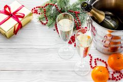 New Year 2018 background. Champagne in bucket, glasses with beverage, tangerines and decoration on grey background. New Year 2018 background. Champagne in bucket Royalty Free Stock Photography