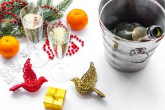 New Year 2018 background. Champagne in bucket, glasses with beverage, spruce branch and decoration on white background.  Royalty Free Stock Photos
