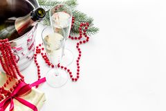 New Year 2018 background. Champagne in bucket, glasses with beverage, spruce branch and decoration on white background Royalty Free Stock Photo