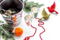 New Year 2018 background. Champagne in bucket, glasses with beverage, spruce branch and decoration on white background.  Royalty Free Stock Image