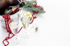 New Year 2018 background. Champagne in bucket, glasses with beverage, spruce branch and decoration on white background.  Stock Photo