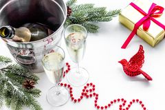 New Year 2018 background. Champagne in bucket, glasses with beverage, spruce branch and decoration on white background.  Royalty Free Stock Photo