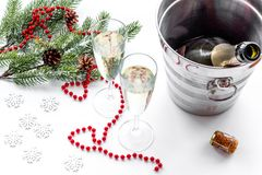 New Year 2018 background. Champagne in bucket, glasses with beverage, spruce branch and decoration on white background.  Stock Image