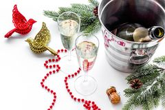 New Year 2018 background. Champagne in bucket, glasses with beverage, spruce branch and decoration on white background Stock Photos