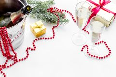 New Year 2018 background. Champagne bucket, glasses with beverage, spruce branch, decoration on white copyspace. New Year 2018 background. Champagne in bucket Royalty Free Stock Photography
