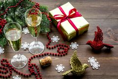 New Year 2018 background. Champagne in bucket, glasses with beverage, spruce branch and decoration on wooden background.  Stock Image