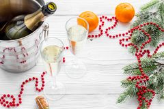 New Year 2018 background. Champagne in bucket, glasses with beverage, tangerines and decoration on grey background. New Year 2018 background. Champagne in bucket Stock Photography