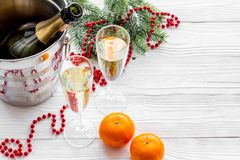 New Year 2018 background. Champagne in bucket, glasses with beverage, tangerines and decoration on grey background. New Year 2018 background. Champagne in bucket Stock Photos