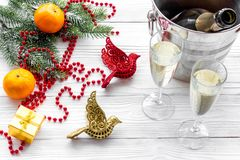 New Year 2018 background. Champagne in bucket, glasses with beverage, tangerines and decoration on grey background. New Year 2018 background. Champagne in bucket Stock Images