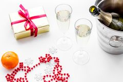 New Year 2018 background. Champagne in bucket, glasses with beverage, tangerines and decoration on white background. New Year 2018 background. Champagne in Royalty Free Stock Photos