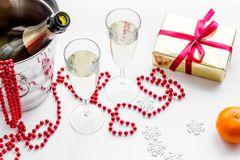New Year 2018 background. Champagne in bucket, glasses with beverage, tangerines and decoration on white background. New Year 2018 background. Champagne in Stock Images
