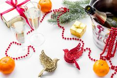 New Year 2018 background. Champagne in bucket, glasses with beverage, tangerines and decoration on white background. New Year 2018 background. Champagne in Stock Photography