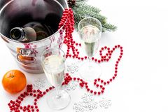 New Year 2018 background. Champagne in bucket, glasses with beverage, tangerines and decoration on white background Royalty Free Stock Photo