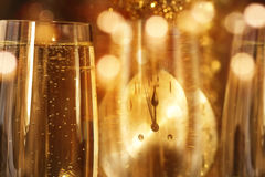 New year background with champagne. New year background with a glass champagne and a clock face Stock Photo