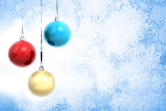 New Year background with Christmas balls. New Year background illustration with three Christmas balls hanging on ribbons above blue frozen glass surface stock illustration