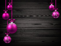 New Year background with Christmas balls. New Year wooden background with pink Christmas balls. Vector illustration Stock Images