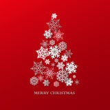 New year background with Christmas tree made of paper snowflakes Stock Photos