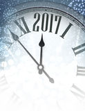 2017 New Year background with clock. 2017 New Year background with clock and fireworks. Vector illustration Stock Photo