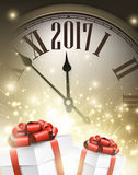 2017 New Year background. 2017 New Year background with clock and gifts. Vector illustration Stock Photo