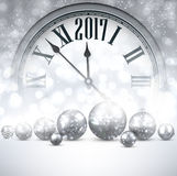 2017 New Year background with clock. 2017 New Year luminous background with clock and balls. Vector illustration royalty free illustration