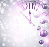 2017 New Year background with clock. 2017 New Year luminous background with clock and balls. Vector illustration Stock Photo