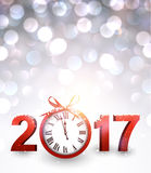 2017 New Year background with clock. 2017 New Year luminous background with red clock. Vector illustration Stock Image