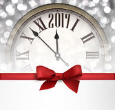2017 New Year background with clock. 2017 New Year background with clock and red bow. Vector illustration Stock Images