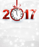 2017 New Year background with clock. 2017 New Year snowy background with red clock. Vector illustration Stock Photo