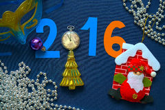 New Year background with date, mask, pocket watches and herringbone Royalty Free Stock Images