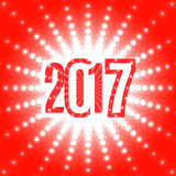 New Year background with the date 2017. And white flash of light on a red Royalty Free Stock Images