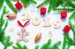 New Year 2019 background with 2019 figures, Christmas toys, blue fir tree branches. Flat lay, top view of New Year 2019 stock photography