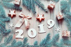New Year 2019 festive background with 2019 figures, festive Christmas toys, blue fir tree branches and white snowflakes royalty free stock photography