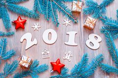 New Year 2018 background with 2018 figures,Christmas toys, fir b Stock Photo