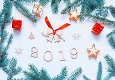 New Year 2019 background with 2019 figures, Christmas toys, fir branches. Flat lay, top view of 2019 festive still life. New Year 2019 background with 2019 royalty free stock photo