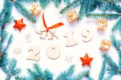 New Year 2019 background,2019 figures,Christmas toys, fir branches. Flat lay, top view-New Year 2019 festive still life stock images