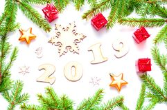 New Year 2019 background with 2019 figures,Christmas toys, fir branches. Flat lay, top view of New Year 2019 still life. New Year 2019 background with 2019 royalty free stock image