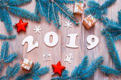 New Year 2019 background, 2019 figures, Christmas toys, fir tree branches. New Year 2019 still life stock photos