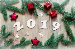 New Year 2019 background, 2019 figures, Christmas toys, green fir tree branches and snowflakes. New Year 2019 still life. New Year 2019 background with 2019 stock photo