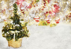 New Year background with a fir-tree and bokeh of toys Royalty Free Stock Images
