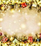 New Year. Background, frame of Christmas tree branches and Christmas decorations. Golden snow. Free space for text. Royalty Free Stock Image