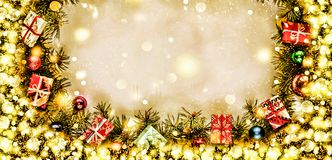 New Year. Background, frame of Christmas tree branches and Christmas decorations. Golden snow. Free space for text. Stock Image