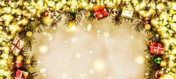New Year. Background, frame of Christmas tree branches and Christmas decorations. Golden snow. Free space for text. Royalty Free Stock Photo