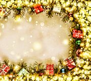 New Year. Background, frame of Christmas tree branches and Christmas decorations. Golden snow. Free space for text. Stock Images