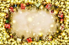 New Year. Background, frame of Christmas tree branches and Christmas decorations. Golden snow. Free space for text. Stock Photography