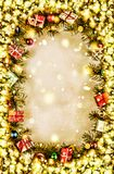 New Year. Background, frame of Christmas tree branches and Christmas decorations. Golden snow. Free space for text. Stock Photos